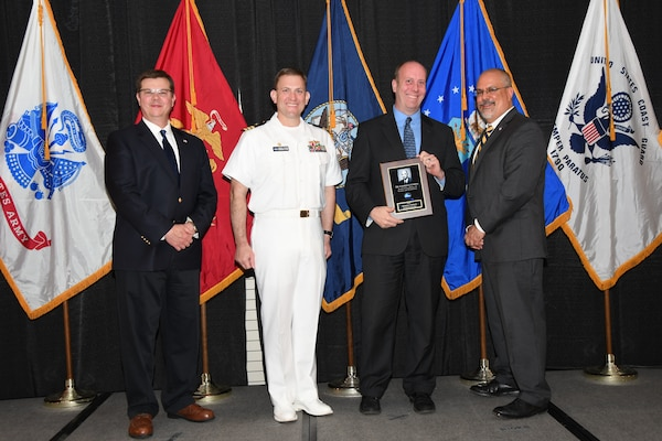 IMAGE: Christian Wahlquist is presented the Dr. Charles J. Cohen Award at Naval Surface Warfare Center Dahlgren Division's annual awards ceremony, Apr. 26 at the Fredericksburg Expo and Conference Center.