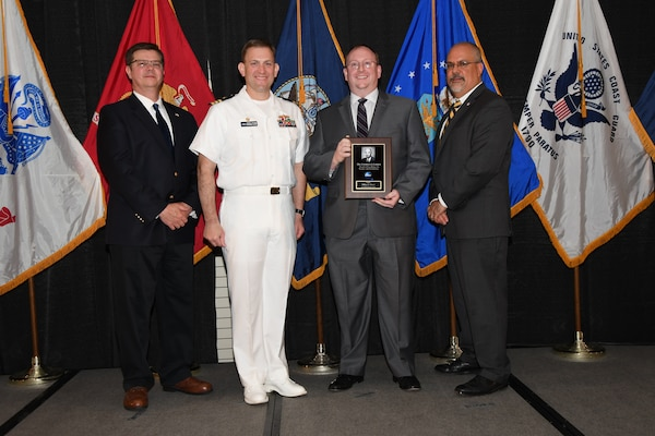 IMAGE: William Moore is presented the Dr. Charles J. Cohen Award at Naval Surface Warfare Center Dahlgren Division's annual awards ceremony, Apr. 26 at the Fredericksburg Expo and Conference Center.