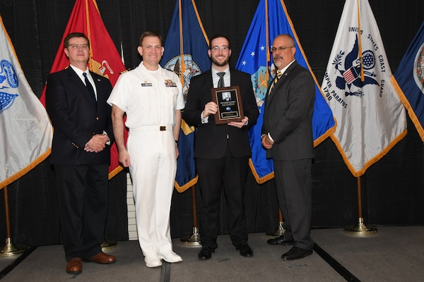 IMAGE: Patrick Mead is presented the Dr. Charles J. Cohen Award at Naval Surface Warfare Center Dahlgren Division's annual awards ceremony, Apr. 26 at the Fredericksburg Expo and Conference Center.