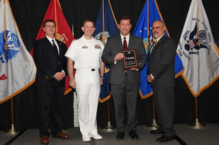 IMAGE: Martin Capone is presented the NSWCDD Award of Excellence for Analysis at Naval Surface Warfare Center Dahlgren Division's annual awards ceremony, Apr. 26 at the Fredericksburg Expo and Conference Center.  The NSWCDD Award of Excellence for Analysis is newly established to recognize individuals who have made a notable and significant impact to NSWCDD through their outstanding performance in analysis - warfare, design, engineering, modeling and simulation.