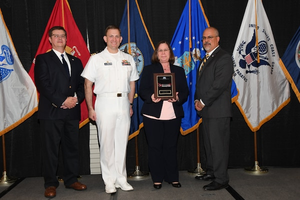 IMAGE: Nancy Taylor is presented the NSWCDD Award of Excellence for Analysis at Naval Surface Warfare Center Dahlgren Division's annual awards ceremony, Apr. 26 at the Fredericksburg Expo and Conference Center.