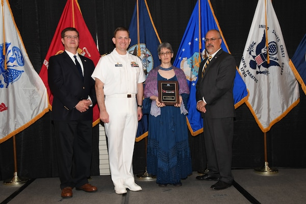 IMAGE: Carolyn Blakelock is presented the NSWCDD Award of Excellence for Analysis at Naval Surface Warfare Center Dahlgren Division's annual awards ceremony, Apr. 26 at the Fredericksburg Expo and Conference Center.