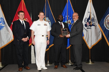 IMAGE: Willie Crank is presented the Commander's Diversity and Inclusion Award at Naval Surface Warfare Center Dahlgren Division's annual awards ceremony, Apr. 26 at the Fredericksburg Expo and Conference Center.  The NSWCDD Award of Excellence for Analysis is newly established to recognize individuals who have made a notable and significant impact to NSWCDD through their outstanding performance in analysis - warfare, design, engineering, modeling and simulation.