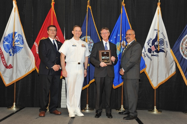 IMAGE: John Morris is presented the  NSWCDD Award of Excellence for Software Engineering and Integration at Naval Surface Warfare Center Dahlgren Division's annual awards ceremony, Apr. 26 at the Fredericksburg Expo and Conference Center.