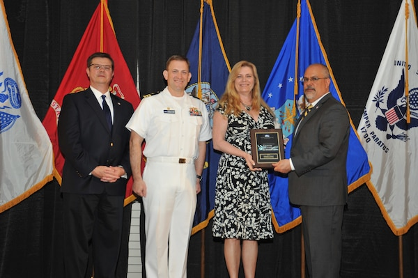 IMAGE: Deborah Daland is presented the  NSWCDD Award of Excellence for Software Engineering and Integration at Naval Surface Warfare Center Dahlgren Division's annual awards ceremony, Apr. 26 at the Fredericksburg Expo and Conference Center.