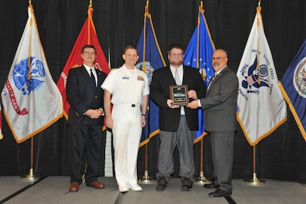 IMAGE: Brian Dillon is presented the  NSWCDD Award of Excellence for Software Engineering and Integration at Naval Surface Warfare Center Dahlgren Division's annual awards ceremony, Apr. 26 at the Fredericksburg Expo and Conference Center.  The NSWCDD Award of Excellence for Software Engineering and Integration was established to recognize individuals who have made a notable and significant impact to NSWCDD through their outstanding performance in Software Engineering & Integration.