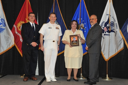 IMAGE: Jeannie Hobgood is presented the Award of Excellence for Systems Engineering and Integration at Naval Surface Warfare Center Dahlgren Division's annual awards ceremony, Apr. 26 at the Fredericksburg Expo and Conference Center.