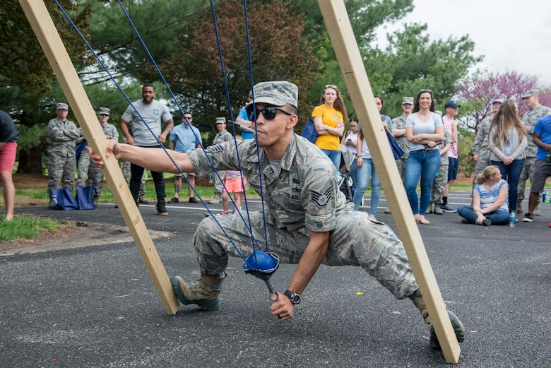 Staff Sgt. Joseph Logrande, 561st Network Operations Squadron Detachment 3, pulls back a water balloon sling shot at Scott Air Force Base's annual Spring Fling and Diversity Day event, May 4, 2018. The event featured a squadron water balloon slingshot contest, where teams built their own slingshot and shot at targets to earn points. (U.S. Air Force photo by Airman 1st Class Chad Gorecki)