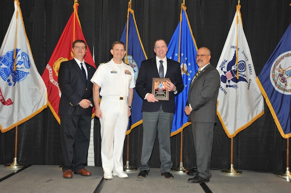 IMAGE: William Bradshaw is presented the Award of Excellence for Systems Engineering and Integration at Naval Surface Warfare Center Dahlgren Division's annual awards ceremony, Apr. 26 at the Fredericksburg Expo and Conference Center.
