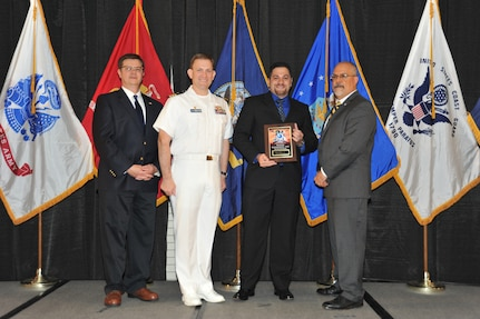 IMAGE: Emil Jimenez-Brea is presented the Award of Excellence for Systems Engineering and Integration at Naval Surface Warfare Center Dahlgren Division's annual awards ceremony, Apr. 26 at the Fredericksburg Expo and Conference Center.