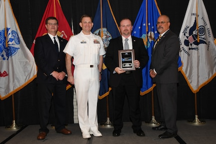 IMAGE: Jeffrey Bunn is presented the NSWCDD Award of Excellence for Test & Evaluation at Naval Surface Warfare Center Dahlgren Division's annual awards ceremony, Apr. 26 at the Fredericksburg Expo and Conference Center.