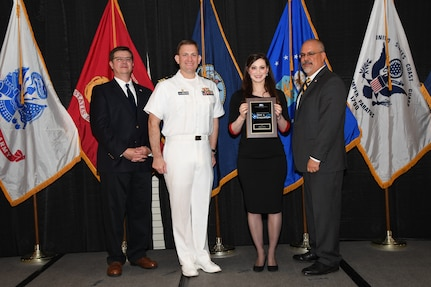 IMAGE: Elena Bono is presented the NSWCDD Award of Excellence for Test & Evaluation at Naval Surface Warfare Center Dahlgren Division's annual awards ceremony, Apr. 26 at the Fredericksburg Expo and Conference Center.