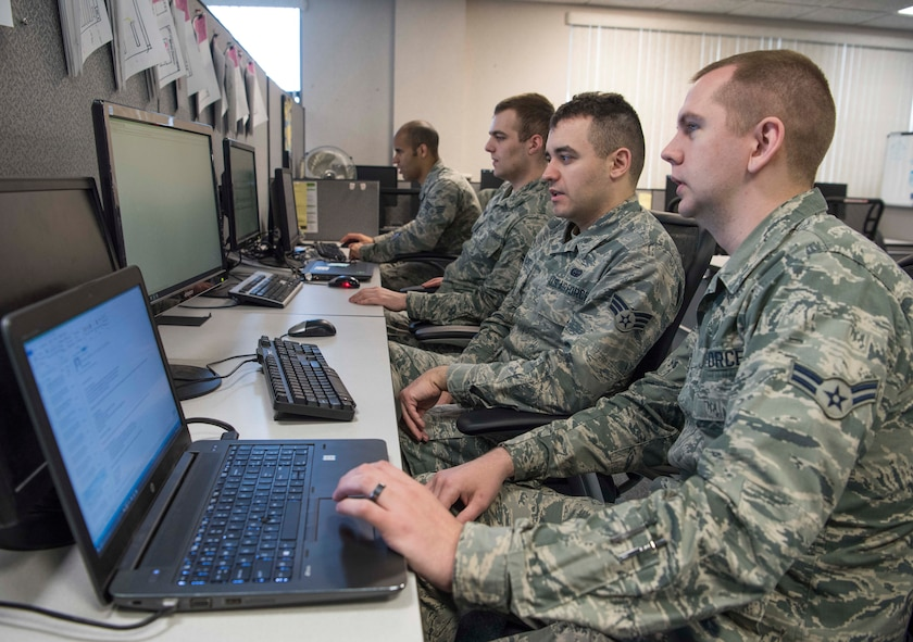 (From left to right) Senior Airman Nigel Krueger, Airman 1st Class Lucas Huesmann, Senior Airman Daniel Gearhart, Airman 1st Class Joshua Perry, 375th Communications Support Squadron Air Mobility Command software developers, work on several software applications April 17, 2018, at Scott Air Force Base, Illinois. The 375th CSPTS supports the 375th Air Mobility Wing in its global reach mission by providing, command, control, communications and computer support to the Department of Defense, United States Transportation Command, AMC, 18th Air Force and others worldwide. (U.S. Air Force photo by Senior Airman Melissa Estevez)
