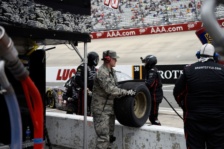 "Airman 1st Class Lance Kielbaso, 436th Maintenance Squadron metals technician apprentice, watches a race as an honorary pit crew member for Spencer Boyd, driver of the No. 76 SS Green Light Racing Chevrolet Camaro car, during the ""OneMain Financial 200"" NASCAR XFINITY Series Dash 4 Cash Race May 5, 2018, at Dover International Speedway, Del. Kielbaso helped the crew with a tire change during a pit stop. (U.S. Air Force photo by Airman 1st Class Zoe M. Wockenfuss)"