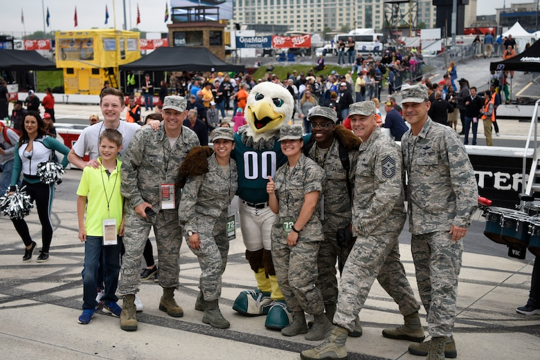"Members from Team Dover get a picture with the Philadelphia Eagles mascot at the ""AAA 400 Drive for Autism"" Monster Energy NASCAR Cup Series race May 6, 2018 at Dover International Speedway, Del. Players from the Philadelphia Eagles participated in the opening ceremonies prior to the start of the race. (U.S. Air Force photo by Airman 1st Class Zoe M. Wockenfuss)"