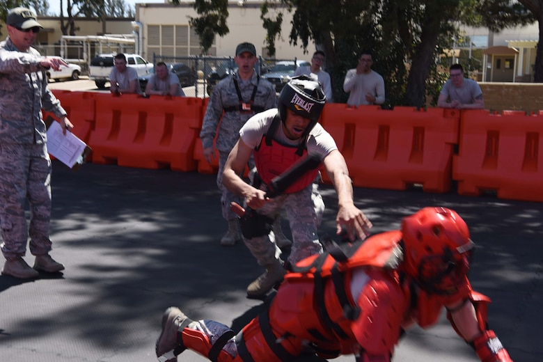 A 30th Security Forces member defeats the perpetrator during training at Vandenberg Air Force Base, May 2, 2018. The Red Man training is a way for SF members to practice their combative skills and to restrain a trespasser with coaching from their supervisors. (U.S. Air Force photo by Airman Aubree Milks/Released)