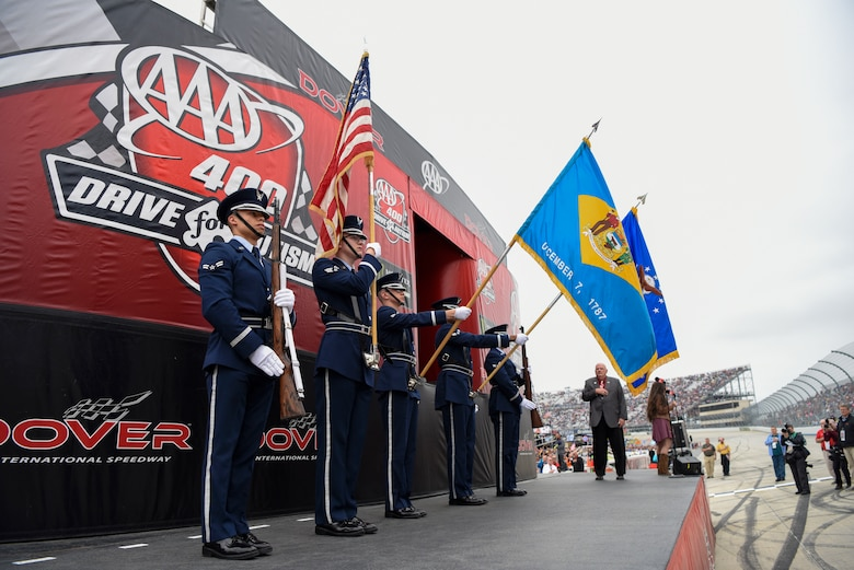 "A Dover Air Force Base Honor Guard color guard team presents the colors at the beginning of the ""AAA 400 Drive for Autism"" Monster Energy NASCAR Cup Series Race May 6, 2018, at Dover International Speedway, Del. American Country music singer Jessica Lynn sang the national anthem and Dan Schafer, pastor of Calvary Assembly of God, Hightstown, N.J., gave the invocation. (U.S. Air Force photo by Airman 1st Class Zoe M. Wockenfuss)"