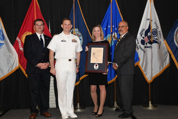 IMAGE: Crystal Breen is presented the Paul J. Martini Award at Naval Surface Warfare Center Dahlgren Division's annual awards ceremony, Apr. 26 at the Fredericksburg Expo and Conference Center.