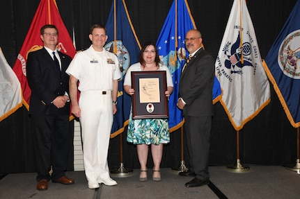 IMAGE: Tanja Hines is presented the Paul J. Martini Award at Naval Surface Warfare Center Dahlgren Division's annual awards ceremony, Apr. 26 at the Fredericksburg Expo and Conference Center.
