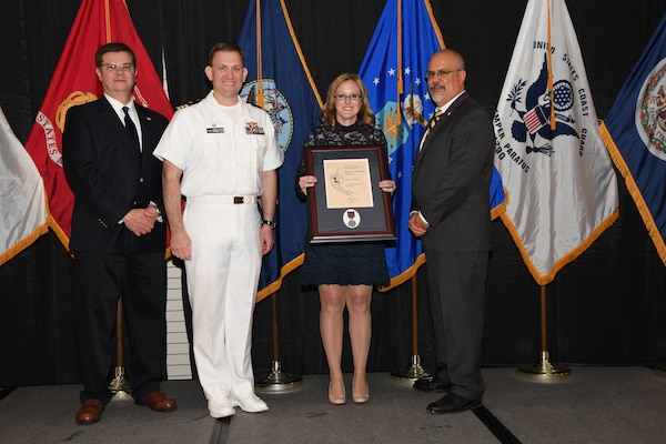 IMAGE: Vikki Rouleau is presented the Paul J. Martini Award at Naval Surface Warfare Center Dahlgren Division's annual awards ceremony, Apr. 26 at the Fredericksburg Expo and Conference Center.