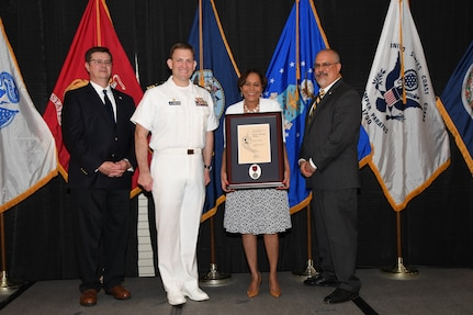 IMAGE: Angela McGee is presented the Paul J. Martini Award at Naval Surface Warfare Center Dahlgren Division's annual awards ceremony, Apr. 26 at the Fredericksburg Expo and Conference Center.