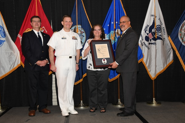 IMAGE: Debbie Newkirk is presented the Paul J. Martini Award at Naval Surface Warfare Center Dahlgren Division's annual awards ceremony, Apr. 26 at the Fredericksburg Expo and Conference Center.