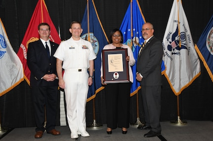 IMAGE: Shantae Collins is presented the Paul J. Martini Award at Naval Surface Warfare Center Dahlgren Division's annual awards ceremony, Apr. 26 at the Fredericksburg Expo and Conference Center.
