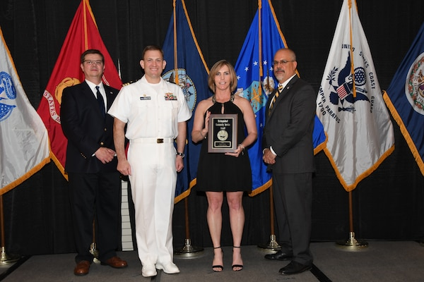 IMAGE: Tracy Sisson is presented the Distinguished Community Service Award at Naval Surface Warfare Center Dahlgren Division's annual awards ceremony, Apr. 26 at the Fredericksburg Expo and Conference Center.