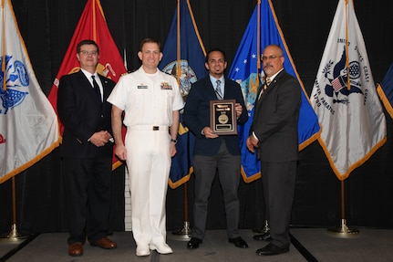 IMAGE: Jose Polo-Morales is presented the Distinguished Community Service Award at Naval Surface Warfare Center Dahlgren Division's annual awards ceremony, Apr. 26 at the Fredericksburg Expo and Conference Center.