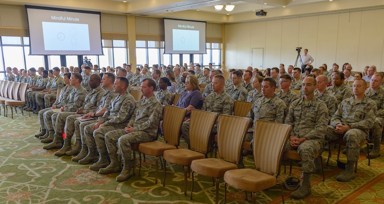 Keesler personnel participate in a stress release exercise led by U.S. Air Force Lt. Col. Jannell MacAulay,  58th Special Operations Wing mindfulness and human performance consultant, Kirtland Air Force Base, New Mexico, in the Bay Breeze Event Center at Keesler Air Force Base, Mississippi, May 1, 2018. MacAulay provided guidance to Keesler personnel to assist in their growth as managers into effective, adaptive and agile leaders while managing the stressors of everyday life. (U.S. Air force photo by Andre' Askew)