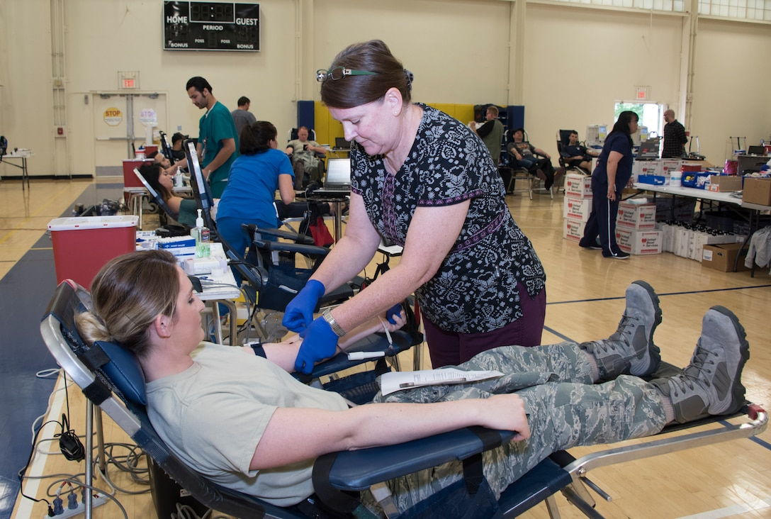 Airman 1st Class Brooke Bohrer, 60th Medical Support Squadron, donates blood, April 27, 2018, Travis Air Force Base, Calif. Since 2012, Travis AFB has supported 4,815 patients. Just one pint of donated blood can help save as many as three people's lives. (U.S. Air Force Photo by Heide Couch)