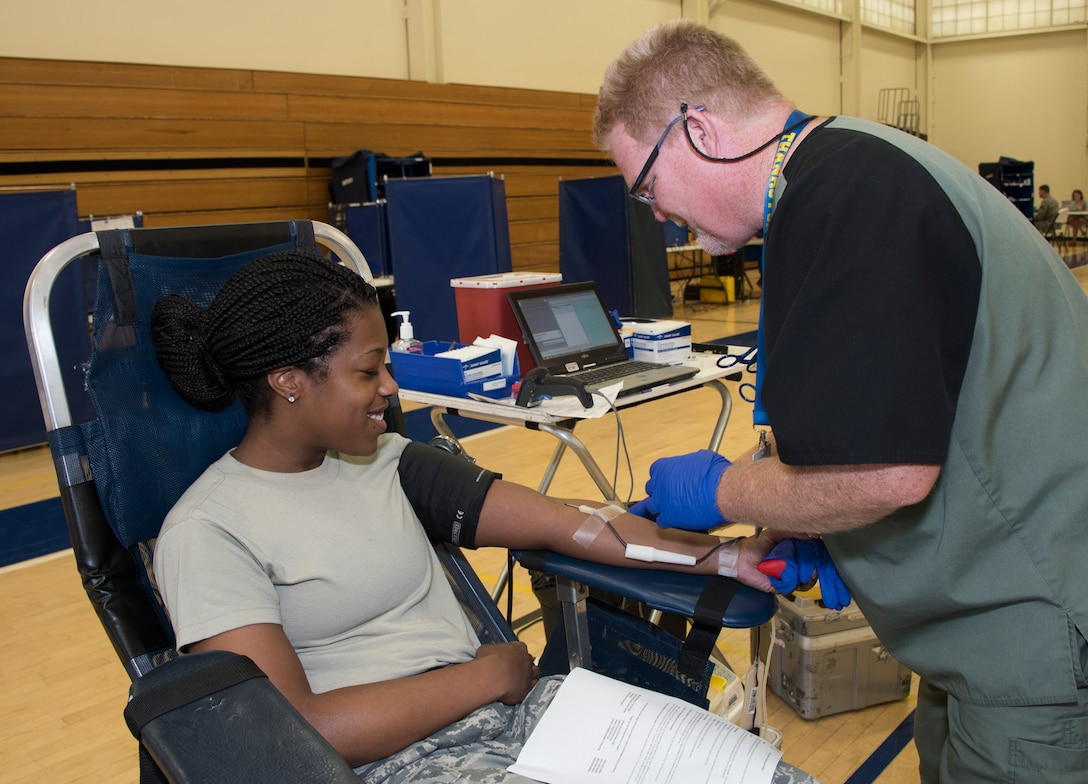Staff Sgt. Anita Richard, 60th Medical Surgical Squadron, donates blood, April 27, 2018, Travis Air Force Base, Calif. Since 2012, Travis AFB has supported 4,815 patients. Just one pint of donated blood can help save as many as three people's lives. (U.S. Air Force Photo by Heide Couch)