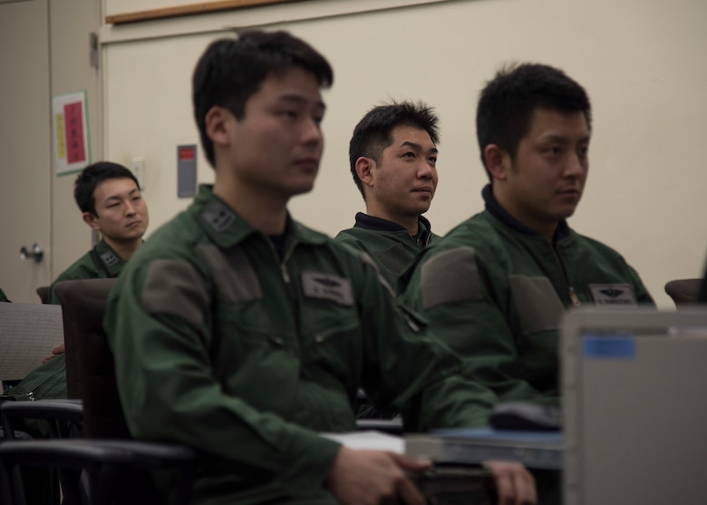 Japan Air Self-Defense Force pilots with the 3rd Air Wing attend a dissimilar air combat tactics brief at Misawa Air Base, Japan, April 12, 2018. The monthly training builds understanding and support between Japan and U.S. forces. (U.S. Air Force photo by Airman 1st Class Collette Brooks)