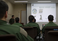 Japan Air Self-Defense Force pilots with the 3rd Air Wing attend a mass briefing on dissimilar air combat tactics at Misawa Air Base, Japan, April 12, 2018. The DACT program provides a realistic application of fighter tactics and serves to develop a high level of tactical skill for all combat aircrews. (U.S. Air Force photo by Airman 1st Class Collette Brooks).