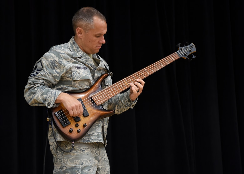 U.S Air Force Master Sgt. Mark Frandsen, U.S. Air Force Band of the Pacific Trends bass player, warms up before the band's performance at Osan Middle High School, Osan Air Base, Republic of Korea, May 7, 2018. The concert's set included American songs from today's pop culture and classic rock from the 1980s, with solos from the various band members. (U.S. Air Force photo by Airman 1st Class Ilyana A. Escalona)