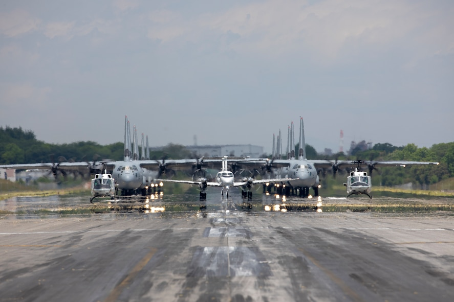 Aircraft from the 374th Airlift Wing (AW) conduct the 374th AW Generation Exercise Elephant Walk