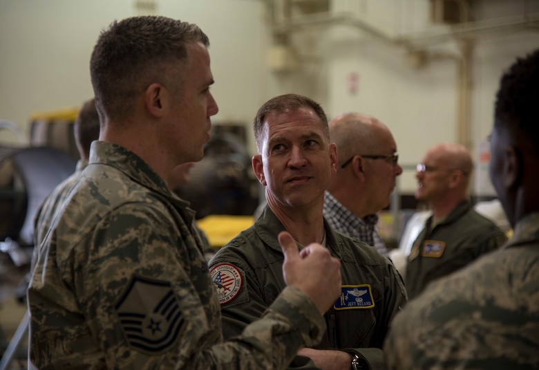 U.S. Air Force Master Sgt. Christopher Browne, left, the 35th Maintenance Squadron jet engine intermediate maintenance section chief, and USAF Brig. Gen. Jeffrey C. Bozard, right, the 5th Air Force vice commander, discuss operations at Misawa Air Base, Japan, May 1, 2018. Bozard noticed and reassured Team Misawa members' commitment and devotion to the mission's value. (U.S. Air Force photo by Airman 1st Class Collette Brooks)