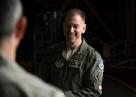 U.S. Air Force Brig. Gen. Jeffrey C. Bozard, the 5th Air Force vice commander, speaks with an Airman during his tour of Misawa Air Base, Japan, May 2, 2018. When meeting with Airmen, Bozard questioned where they were from and what they thought of Misawa to get to know them personally. (U.S. Air Force photo by Airman 1st Class Collette Brooks)