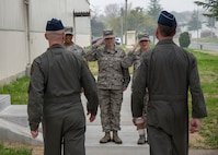 Three Team Misawa Airmen salute U.S. Air Force Col. R. Scott Jobe, left, the 35th Fighter Wing commander, and USAF Brig. Gen. Jeffrey C. Bozard, right, the 5th Air Force vice commander, at Misawa Air Base, Japan, May 2, 2018. Bozard reminded service members that building international relationships contributes to airpower capabilities and mission success. (U.S. Air Force photo by Airman 1st Class Collette Brooks)