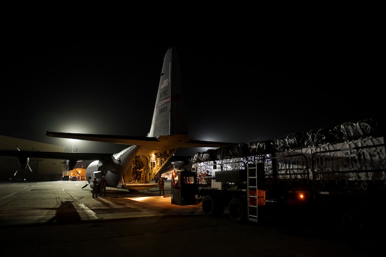 A C-130J Super Hercules and its aircrew assigned to the 746th Expeditionary Airlift Squadron from Al Udeid Air Base, Qatar, loads cargo destined for an undisclosed location in Afghansitan, May 5, 2018.  The 774th EAS is an active duty unit based out of the 41st Airlift Squadron, Little Rock, Ark, that worked together with the 746th EAS, a reserve unit based out of the 403rd Wing at Keesler Air Force Base, Miss. The mission represents the first dual-formation airdrop consisting of aircraft from two separate units. (U.S. Air Force photo by Senior Airman Xavier Navarro)