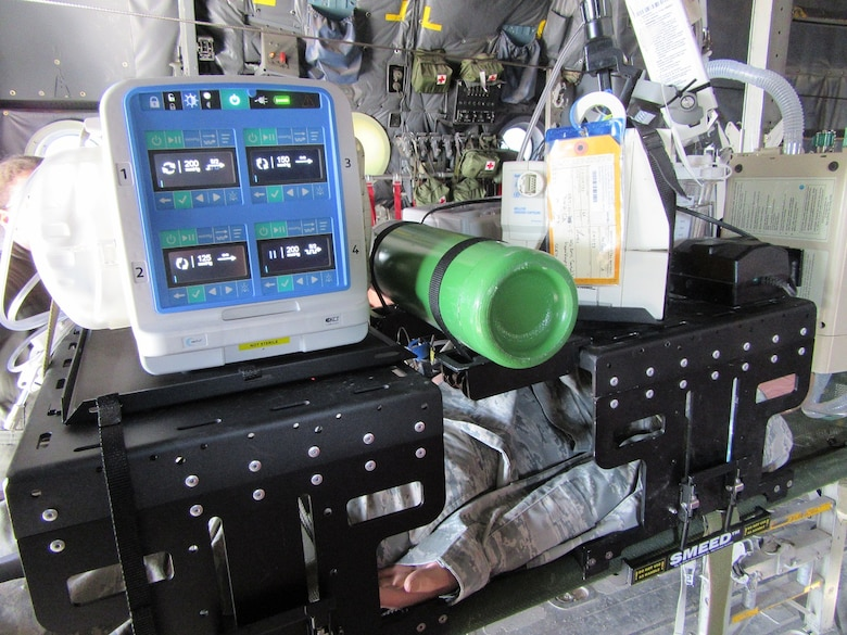 The multi-channel wound vacuum system is tested on a simulated patient in a C-130 static aircraft display at the 59th Medical Wing, San Antonio, Texas, Dec. 1, 2016. The multi-channel wound vacuum system, which is used to promote wound healing on critical patients, is able to replace the capabilities of four single-channel systems. This smaller, more transportable device makes it easier for aeromedical evacuation crews to deliver en route wound care to patients with multiple wounds. The Air Force Medical Evaluation Support Activity (AFMESA) team was involved in the testing of the multi-channel wound vacuum system, ensuring the device could perform in the operational environment. (Courtesy photo)
