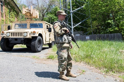 A Soldier, from D Company, 175th Infantry Regiment, Maryland National Guard, guards a downed cell tower as part of Vigilant Guard 18 on May 8, 2018 in Sykesville, Maryland. The downed cell tower represents a portion of Vigilant Guard's various real-world scenarios designed to prepare soldiers and emergency personnel for a potential hurricane landfall.   A Soldier, from D Company, 175th Infantry Regiment, Maryland National Guard, guards a downed cell tower as part of Vigilant Guard 18 on May 8, 2018 in Sykesville, Maryland. The downed cell tower represents a portion of Vigilant Guard's various real-world scenarios designed to prepare soldiers and emergency personnel for a potential hurricane landfall.