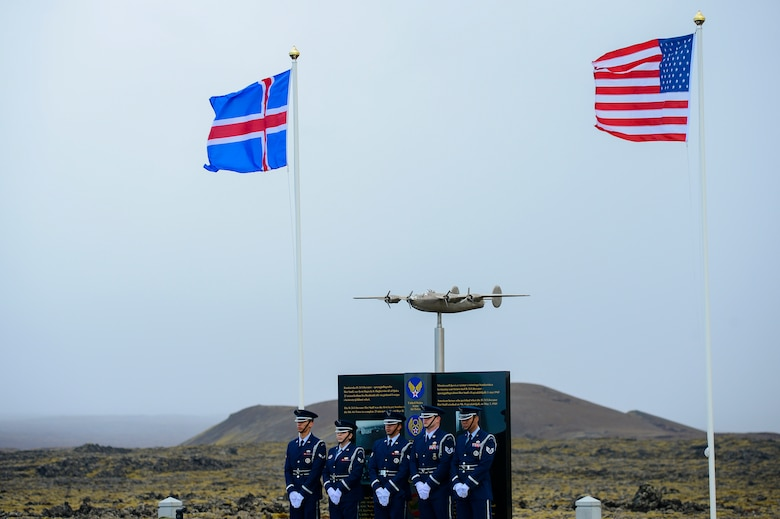 Airmen assigned to the Spangdahlem Air Base Honor Guard pose for a photo in front of a monument dedicaed to Lt. Gen. Frank Maxwell Andrews and his crew, May 3, 2018, in Keflavic, Iceland. The ceremony recognized the 75th anniversary of the crash of a B-24 Liberator which resulted in the death of Andrews and 13 members of his crew. (U.S. Air Force photo/Staff Sgt. Kenny Holston)