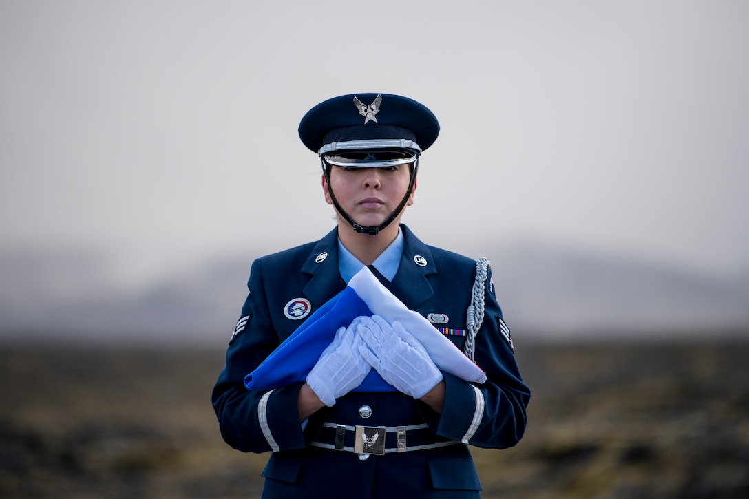 An Airmen assigned to the Spangdahlem Air Base Honor Guard prepares to raise the Iceland flag during the opening ceremony of a monument dedication, May 3, 2018 in Keflavic, Iceland. The ceremony recognized the 75th anniversary of the crash of a B-24 Liberator which resulted in the death of Lt. Gen. Frank Maxwell Andrews and 13 members of his crew. (U.S. Air Force photo/Tech. Sgt. Robert Cloys)