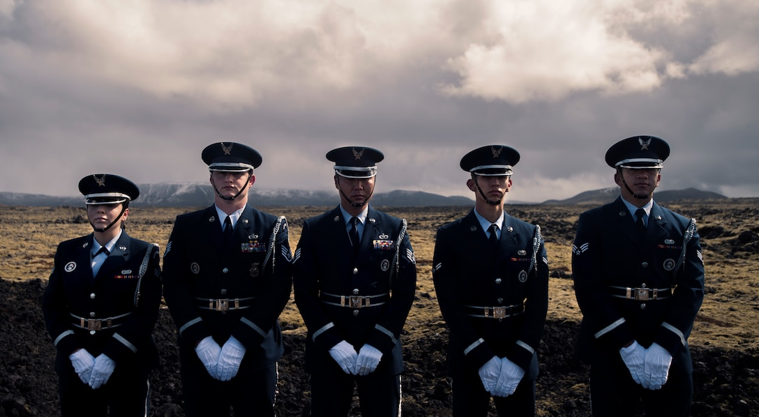 "Members of Spangdahlem Air Base, Germany, Ceremonial Guard pose for a photo during a monument dedication ceremony to honor the crew of B-24 Liberator ""Hot Stuff"" at Keflavic Air Station, Iceland, May 3, 2018.  As two of the founding nations of NATO, Iceland and the U.S. continue their long and enduring relationship of seamless cooperation as allies.  (U.S. Navy photo by MC3 Evan Parker)"