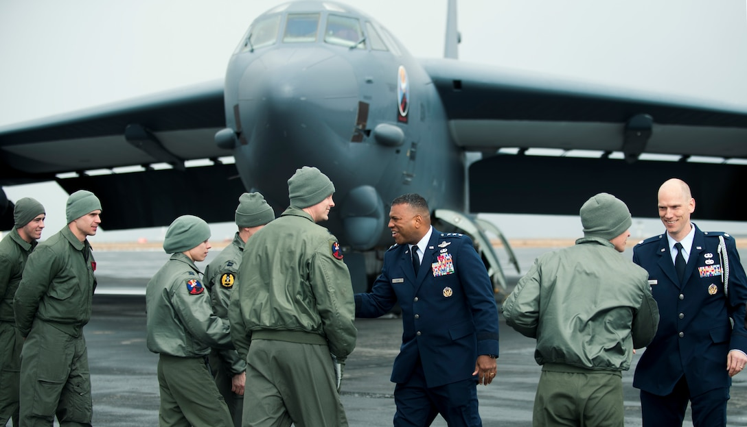 "Lt. Gen. Richard Clark, 3rd Air Force commander, welcomes the crew of a United State Air Force B-52 Stratofortress, deployed from Minot Air Force Base, N.D., after a ceremonial flyover for a monument dedication to honor the crew of the B-24 Liberator ""Hot Stuff"" at Keflavic Air Station, Iceland, May 3, 2018.  As the ""gateway to the Arctic,"" Iceland serves as an important transit point to over 1,000 U.S., NATO military and government aircraft each year traveling between Europe and North America. (U.S. Navy photo by MC3 Evan Parker)"