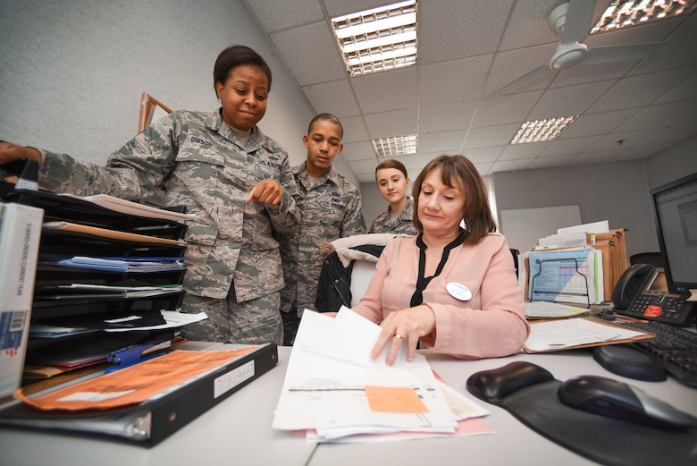 U.S. Airmen from the 100th Force Support Squadron receive training from Jennifer Munns, 100th FSS Force Management military personnel clerk, at RAF Mildenhall, England, April 17, 2018. Military personnel flight Airmen are the heart of the mission, ensuring Airmen and their families are cared for when they arrive and leave the base. (U.S. Air Force photo by Senior Airman Christine Groening)