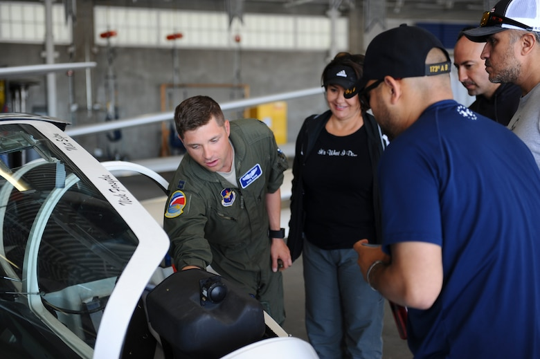 Capt. Karl Bohn, 94th Flying Training Squadron, highlights the different aspects of a glider cockpit prior to the orientation flight for the wounded warriors May 8, 2018, at the Air Force Academy, Colo. The training squadron partnered with the Soaring Eagle Foundation and the Wounded Warrior Program to provide eight veterans the opportunity to soar over the Front Range. (U.S. Air Force photo/Master Sgt. Julius Delos Reyes)