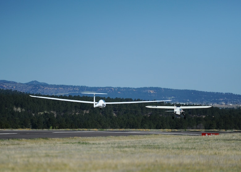 An aircraft tows a glider during an orientation flight for the wounded warriors May 8, 2018, at the Air Force Academy, Colo. Eight veterans received an opportunity to ride on a glider and soar over the Front Range. (U.S. Air Force photo/Master Sgt. Julius Delos Reyes)