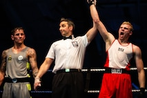 U.S. Marine Corps Cpl. Kreed Gentz, a main battle tank technician with 1st Tank Battalion and boxer with the 1st Marine Division boxing team, is declared the winner of the third bout against British Royal Marine 1st Class Aiden Thompson in a boxing competition at Commando Training Centre for the Royal Marines Lympstone, England, May 3, 2018. The 1st MARDIV boxing team and RMs were scheduled to compete in a friendly boxing exposition to strengthen the bond of both counterparts.